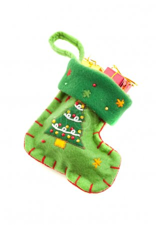 Photo pour Small green Christmas sock isolated on white - image libre de droit