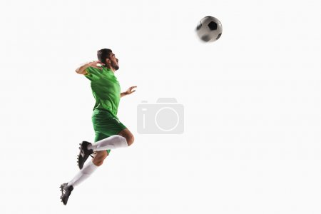 Athlete heading soccer ball