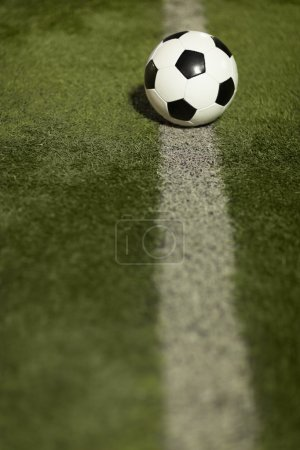 Soccer ball on sports field
