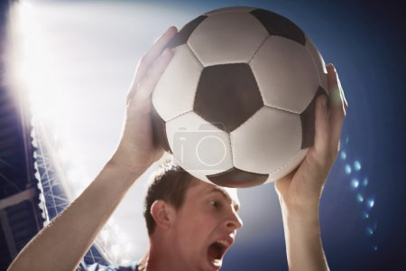 Athlete with soccer ball in her hands