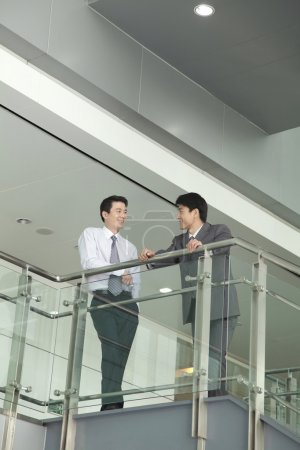 Businessmen Talking on Stairway