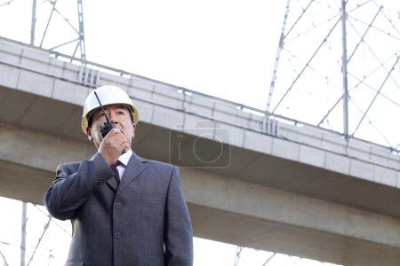 Businessman on Walkie Talkie