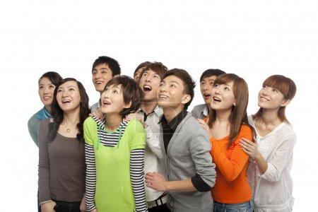 Photo for Group of young people looking up in excitement - Royalty Free Image