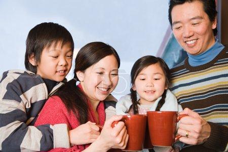 Family having hot drinks