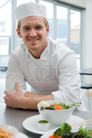 Chef with meal