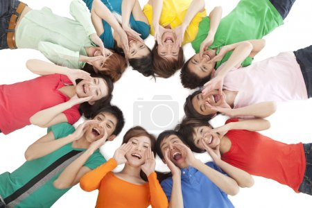 Photo for A group of young people shouting in a circle - Royalty Free Image