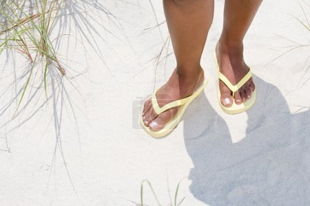 Woman wearing flip flops
