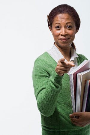 Portrait of teacher holding books