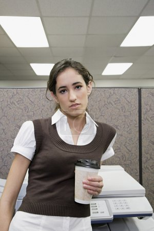 Female office worker with coffee