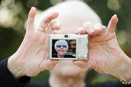 Senior woman taking a self portrait photograph