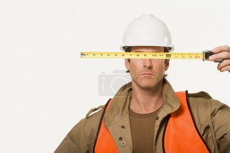 construction worker with meter