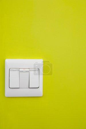 Light switch on yellow wall