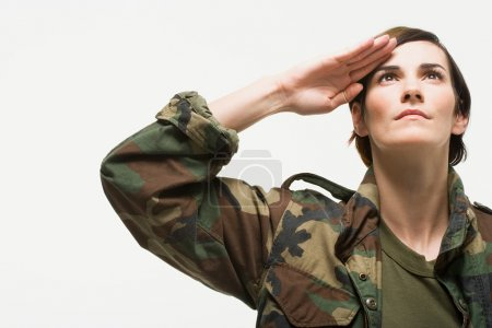 Photo for Portrait of a woman soldier salutes - Royalty Free Image
