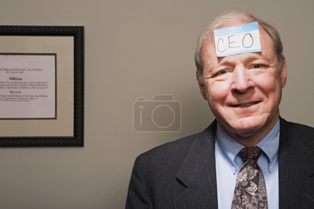 Photo for Mature businessman achieving success - Royalty Free Image