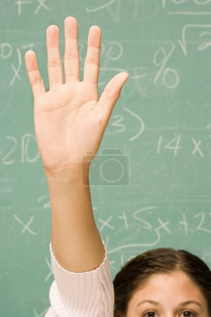 Female student with her hand raised