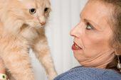 Senior woman with pet cat