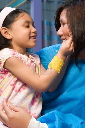 Nurse holding happy girl