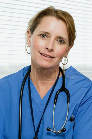 Portrait of a female blonde doctor