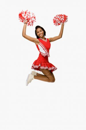 Cheerleader jumping and smiling