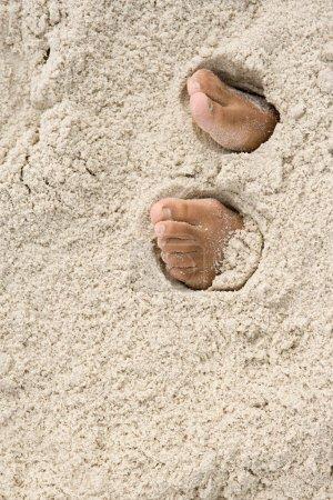 Feet under sand