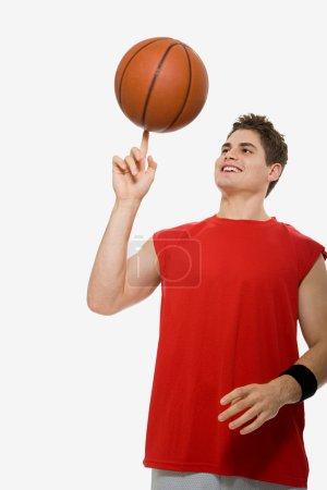 Basketball player with ball smiling