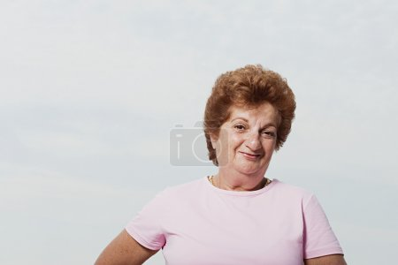 Senior woman wearing a pink t-shirt