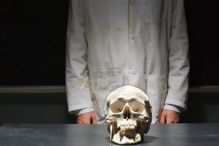Student stood with a human skull