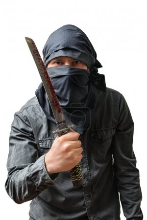 Terrorist holds bloody knife. Isolated on white. Terrorism concept