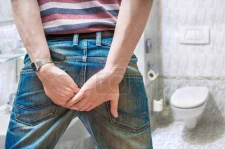 Man suffers from diarrhea in restroom.