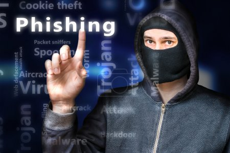 Masked anonymous hacker is pointing on Phishing