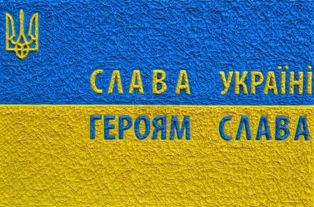 The famous ukrainian tagline Glory to Ukraine! Glory to the heroes in national yellow and blue colours. A symbol of Ukraine.