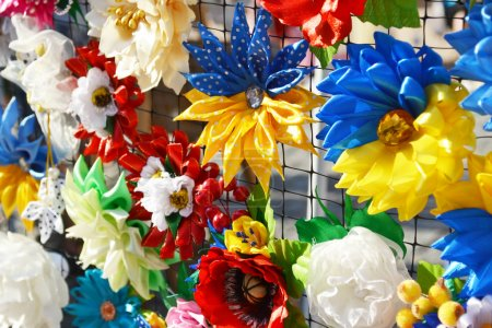 Symbolic Ukrainian flowers, ribbons and bows in the national blue and yellow colors