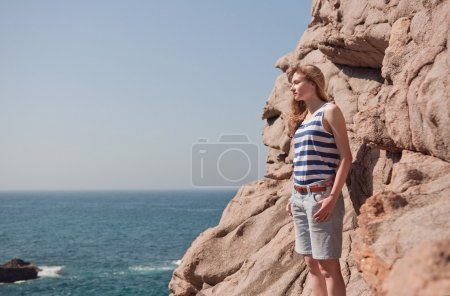 Young woman looking at ocean