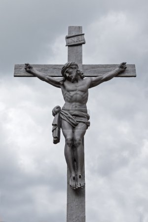 Crucifixion against cloudy sky