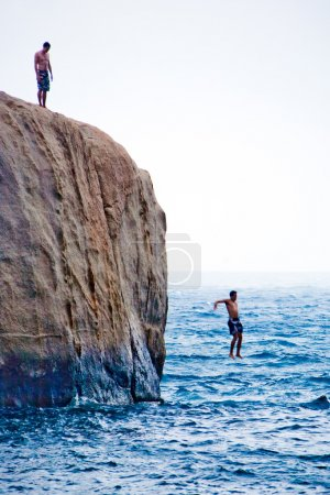 Guy jumping from the rock