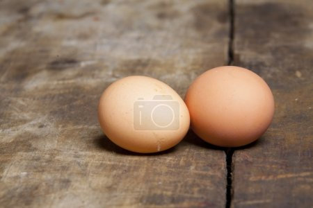 Photo for Fresh rural chicken eggs on wooden table - Royalty Free Image
