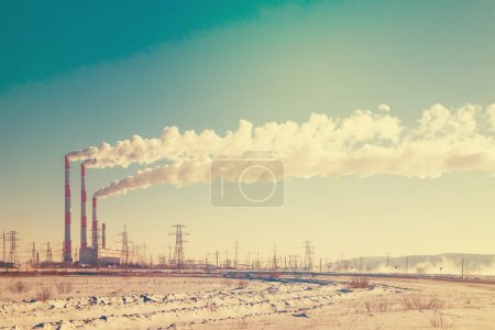 Industrial view of factory pipes with smoke