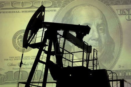 Oil pump with dollar banknote