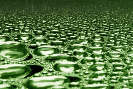 Water drops on polished metal surface