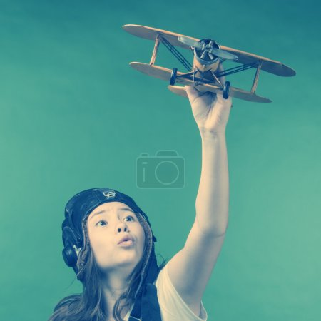 Cute young girl with airplane model