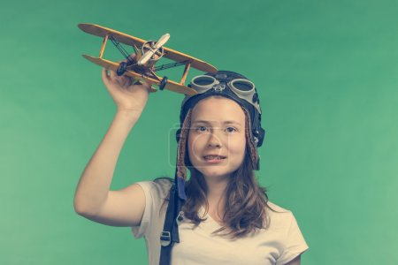 Cute girl playing with airplane model