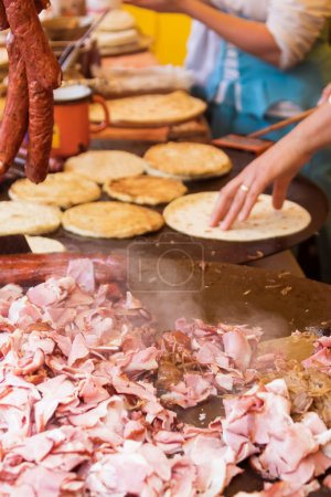 Fried meat on large metal pan