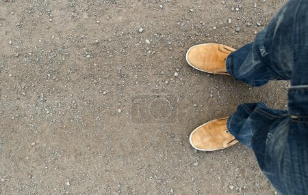 Photo for Yellow boots on the road, a man standing on the road - Royalty Free Image