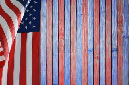 Photo for Patriotic table with US flag. The wood table is painted red and blue. Good background for Memorial Day or 4th of July themes - Royalty Free Image
