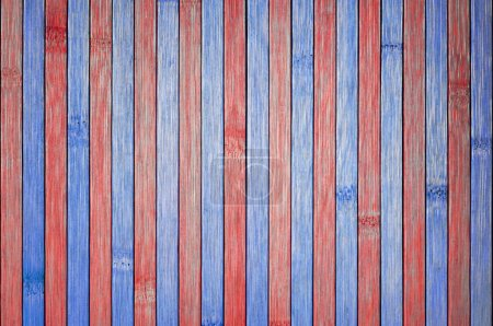 Photo for Patriotic picnic table. The wood table is painted red and blue. Good background for Memorial Day or 4th of July themes - Royalty Free Image