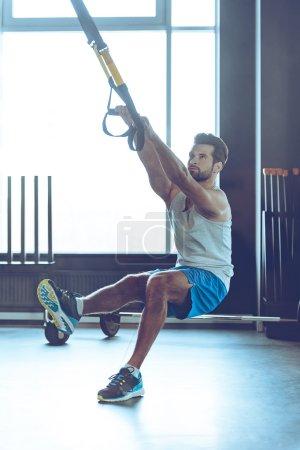 young man  exercising at gym
