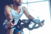young man  cycling at gym