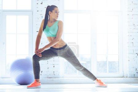 woman in sportswear stretching
