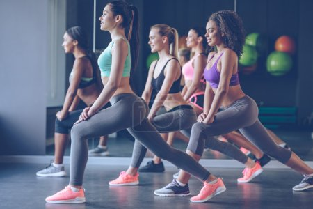 Women exercising with smile at gym
