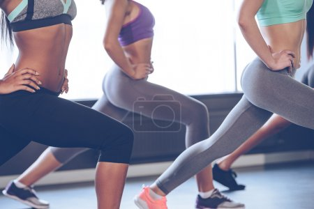 Young women with perfect buttocks exercising